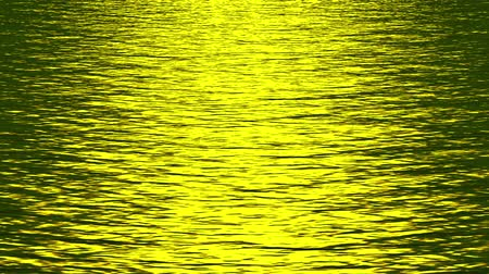 harmonia : shine golden light reflecting on ocean.