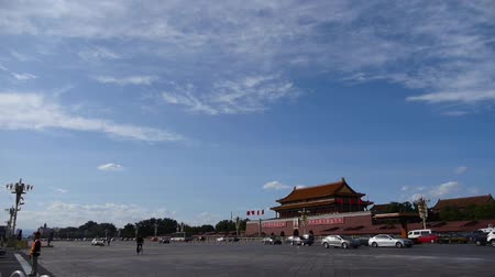 peking : Beijing Tiananmen Square sunny cloud scene,Bustling Changan Street,traffic.
