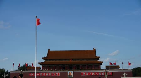 peking : Chinese red flag flutters in wind.China Beijing Tiananmen Square plaza. Stock mozgókép