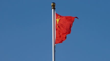 socialist republic : Chinese red flag flutters in wind & blue sky. Stock Footage