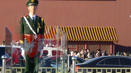 peking : Guard Soldier on Beijing Tiananmen,China socialist red wall.Street traffic.