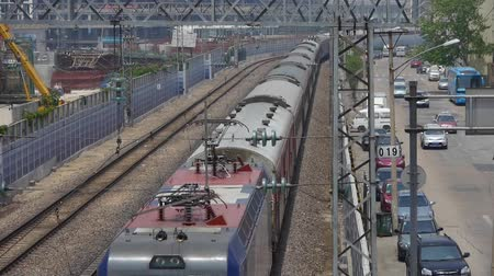 trilho : overlook train slowly passing,intercity traffic in china.