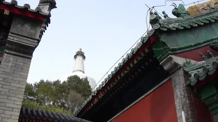 brickwall : China ancient architecture White Tower in temple,Beijing Beihai Park. Stock Footage