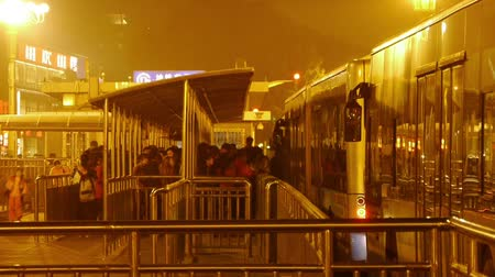 annoyance : bus station & waiting crowd in Beijing at night.
