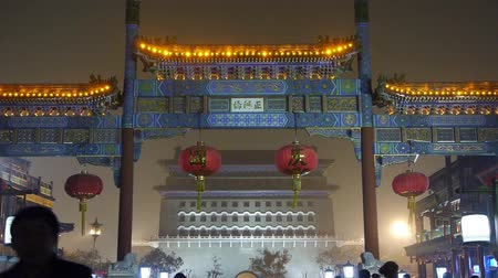 peking : timelapse crowd walk in China Beijing night market,memorial arch & lantern.