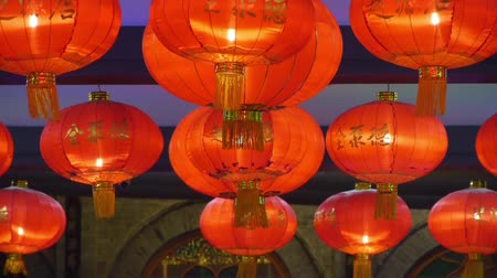 escarlate : Red lanterns tassel at night,elements of East,china new year.