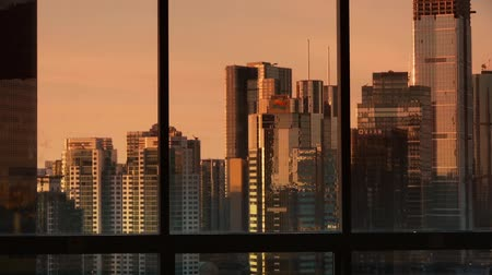 glass building : view modern urban high-rise from windows in dusk,business financial center. Stock Footage