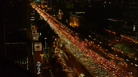bottleneck : night traffic pollution in city,cars jam troop on busy overpass.