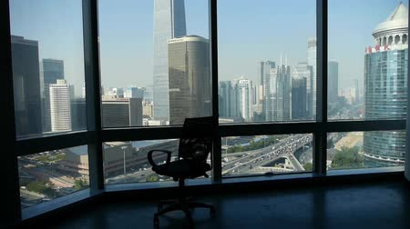 прихожая : an empty chair rotating against business building from french window.