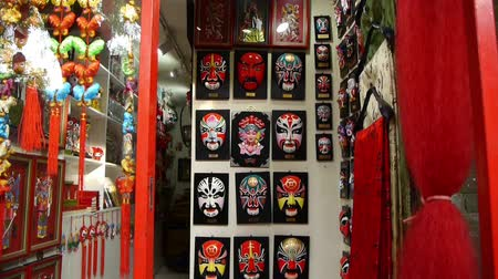 saçak : Beijing Opera mask on the store wall,chinese tradition art culture. Stok Video