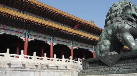 császári : bronze lion in front of Forbidden City,Chinas royal ancient architecture.