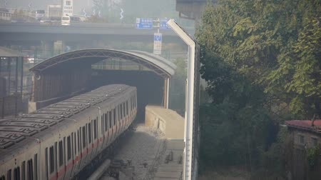 trilho : subway through tunnel in beijing,haze pollution in urban city.