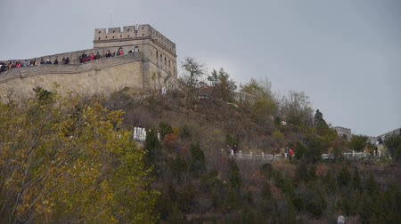посетитель : visitor climbing Great Wall on mountain peak,China ancient architecture,fortress.