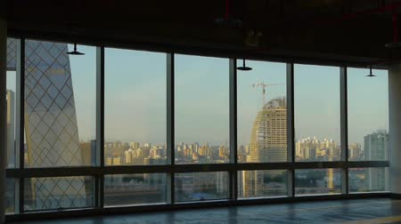 glass building : view modern architecture from building window,escape layer,sun pass through window.