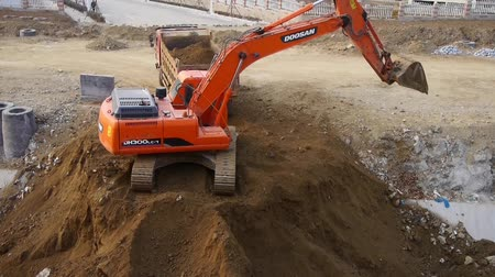 truck crane : excavator and dumper truck on construction site.