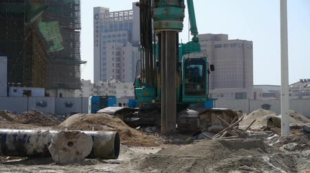 truck crane : drill machinery drilling on construction site.