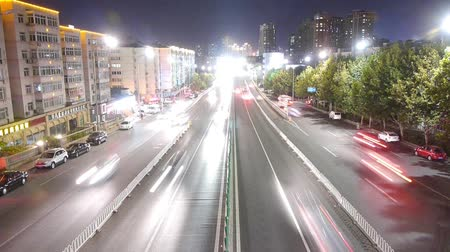 életmód : timelapse urban traffic at night. Stock mozgókép