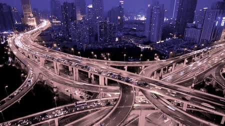 streaking : Aerial View of freeway busy city rush hour heavy traffic jam highway,shanghai Yanan East Road Overpass interchange,Timelapse of driving & cars racing by with streaking lights trail at night with super long exposures for each frame.