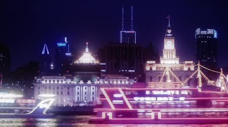 neon light : time lapse,Brightly lit ships cruising Shanghai Bund at night,old europe style building neon lights reflect on huangpu river,water waves.