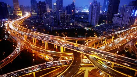 auto estrada : Aerial View of freeway busy city rush hour heavy traffic jam highway,shanghai Yanan East Road Overpass interchange,Timelapse of driving & cars racing by with streaking lights trail at night with super long exposures for each frame.