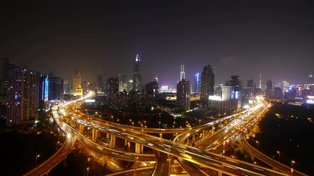 streaking : Aerial View of freeway busy city rush hour heavy traffic jam highway,shanghai Yanan East Road Overpass interchange,driving & cars racing by with streaking lights trail at night with super long exposures for each frame.