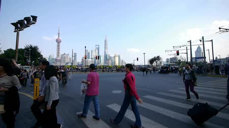 people crossing the road with Shanghai lujiazui business building background.z1 x2 c3=people crossing the road with Shanghai lujiazui business building background.