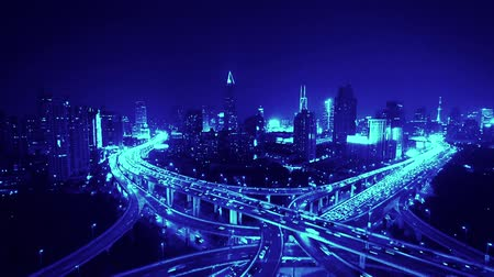 skyscraper : time lapse,Aerial View of freeway busy city rush hour heavy traffic jam highway,shanghai Yanan East Road Overpass interchange,driving racing by with streaking lights trail with super long exposures.