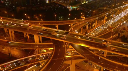 streaking : Aerial View of freeway busy city rush hour heavy traffic jam highway,shanghai Yanan East Road Overpass interchange,driving racing by with streaking lights trail ,time lapse.