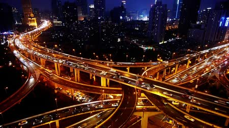 аллея : Aerial View of freeway busy city rush hour heavy traffic jam highway,shanghai Yanan East Road Overpass interchange,Brightly lit modern urban building.
