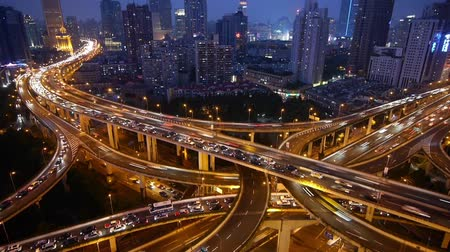 encruzilhada : Aerial View of freeway busy city rush hour heavy traffic jam highway,shanghai Yanan East Road Overpass interchange,Timelapse of driving & cars racing by with streaking lights trail at night with super long exposures for each frame.