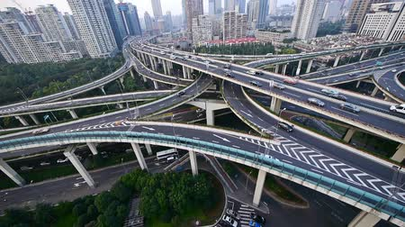 time lapse,Aerial View of freeway busy city rush hour heavy traffic jam highway,shanghai Yanan East Road Overpass interchange,urban building.