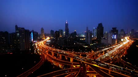 streaking : Aerial View of freeway busy city rush hour heavy traffic jam highway,shanghai Yanan East Road Overpass interchange,driving & cars racing by with streaking lights trail at night,modern building. Stock Footage