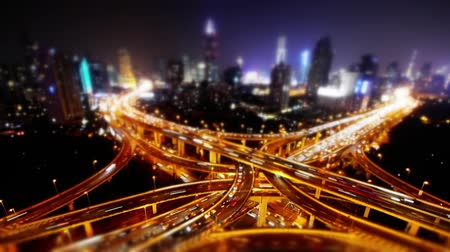streaking : blur shot,Aerial View of freeway busy city rush hour heavy traffic jam highway,shanghai Yanan East Road Overpass interchange,driving racing by with streaking lights trail with super long exposures.