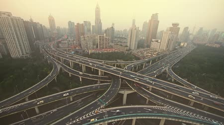 car traffic : time lapse,Aerial View of freeway busy city rush hour heavy traffic jam highway,shanghai Yanan East Road Overpass interchange,urban building haze.