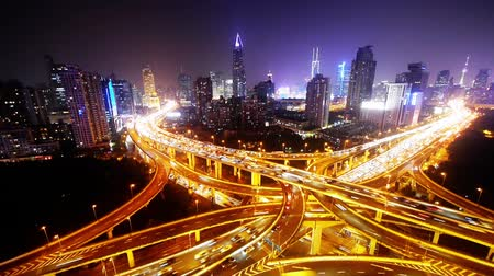 streaking : time lapse,Aerial View of freeway busy city rush hour heavy traffic jam highway,shanghai Yanan East Road Overpass interchange,driving racing by with streaking lights trail with super long exposures.