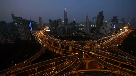 streaking : time lapse,Aerial View of freeway busy city rush hour heavy traffic jam highway,shanghai Yanan East Road Overpass interchange,driving & cars racing by with streaking lights trail at night.