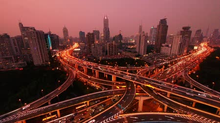 light trails : time lapse,Aerial View of freeway busy city rush hour heavy traffic jam highway,shanghai Yanan East Road Overpass interchange,driving & cars racing by with streaking lights trail from day to night.