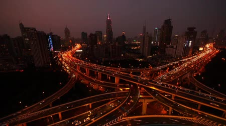 light trails : time lapse,Aerial View of freeway busy city rush hour heavy traffic jam highway,shanghai Yanan East Road Overpass interchange,driving & cars racing by with streaking lights trail at night.