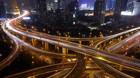 streaking : Aerial View of freeway busy city rush hour heavy traffic jam highway at night,shanghai Yanan East Road Overpass interchange,driving & cars racing by with streaking lights trail with super long exposures for each frame.