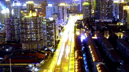 avenida : freeway busy city rush hour heavy traffic jam highway Shanghai at night,the light trails of traffic with super long exposures for each frame,timelapse,Brightly lit urban morden building. Stock Footage