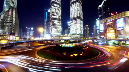 light trails : the light trails of city traffic on the modern building background in shanghai china,time lapse.