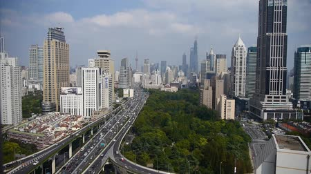 skyscraper : time lapse,Aerial View of freeway busy city rush hour heavy traffic jam highway,shanghai Yanan East Road Overpass interchange,modern business skyscraper building,urban green space,,orient pearl tower. Stock Footage