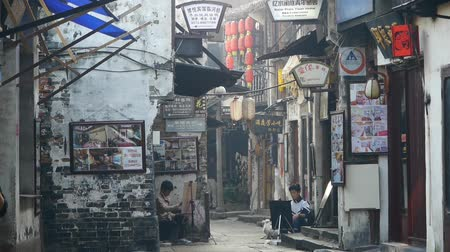 jiangsu : traditional Chinese old town houses & street,Chinese residents life,some students drawing.   Stock Footage