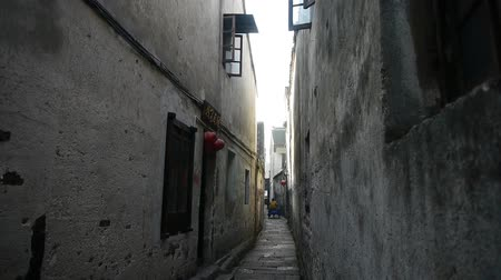 jiangsu : Chinese residents through traditional Chinese old town high wall & street.