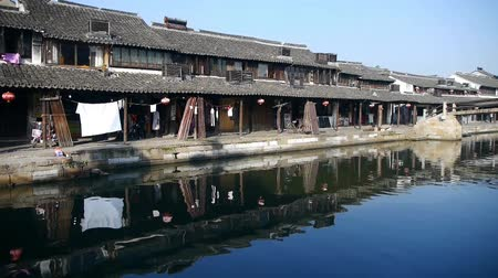jiangsu : Traditional Chinese houses reflection on blue water,shanghai,China. Stock Footage