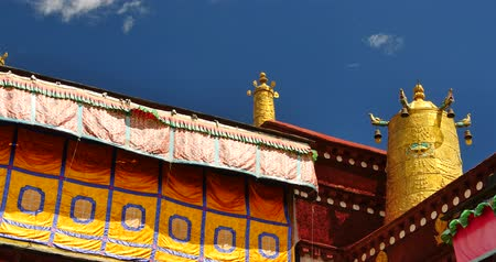 tibeti : 4k closeup of The Jokhang Temple In Lhasa, Tibet, white clouds in blue sky. Stock mozgókép