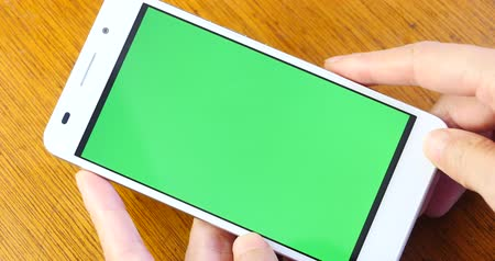 применения : 4k Hand using green screen smartphone Стоковые видеозаписи