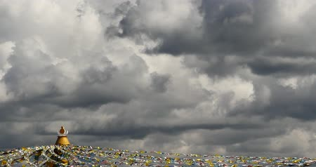 modlitba : 4k prayer flag in wind, clouds background.