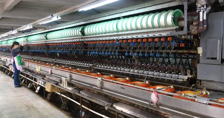 hedvábí : silk textile factory production line,silkworm cocoon at silk factory,women reeling at workshop.