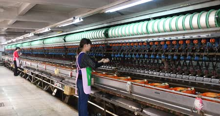 busy line : factory production line,silkworm cocoon at silk factory,women reeling at workshop.